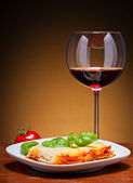 Lasagna and red wine — Stock Photo