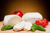 Mozzarella, tomatoes and basil — Stock fotografie
