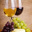 Still life with grapes, cheese and wine — Stock Photo