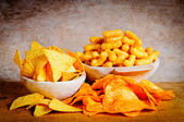 Chips, nachos and curls — Stock Photo