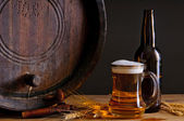 Beer and wooden barrel — Stock Photo
