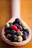 Pepper in wooden spoon — Stock Photo