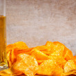 Background with beer and chips — Stock Photo #11054932