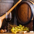 Red wine and wooden barrels — Stock Photo