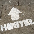 Royalty-Free Stock Photo: Hostel sign on the ground