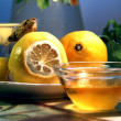 Still life with a saucer of honey and the lemons — Stock Photo