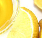 Close-up shot of honey and the lemons. — Stock Photo
