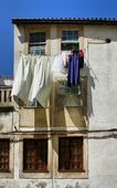 Drying clothes on house window — Stock Photo