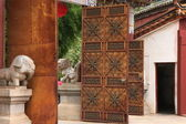 Rusty iron gates of the Huating-Pavilion of Splendour Buddhist Temple. — Stock Photo