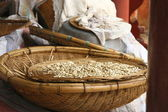 Pumpkin seeds in a wicker basket, Huating buddhist temple. — Stock Photo