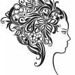 Royalty-Free Stock Vektorfiler: Girl with a beautiful flowers in her hair
