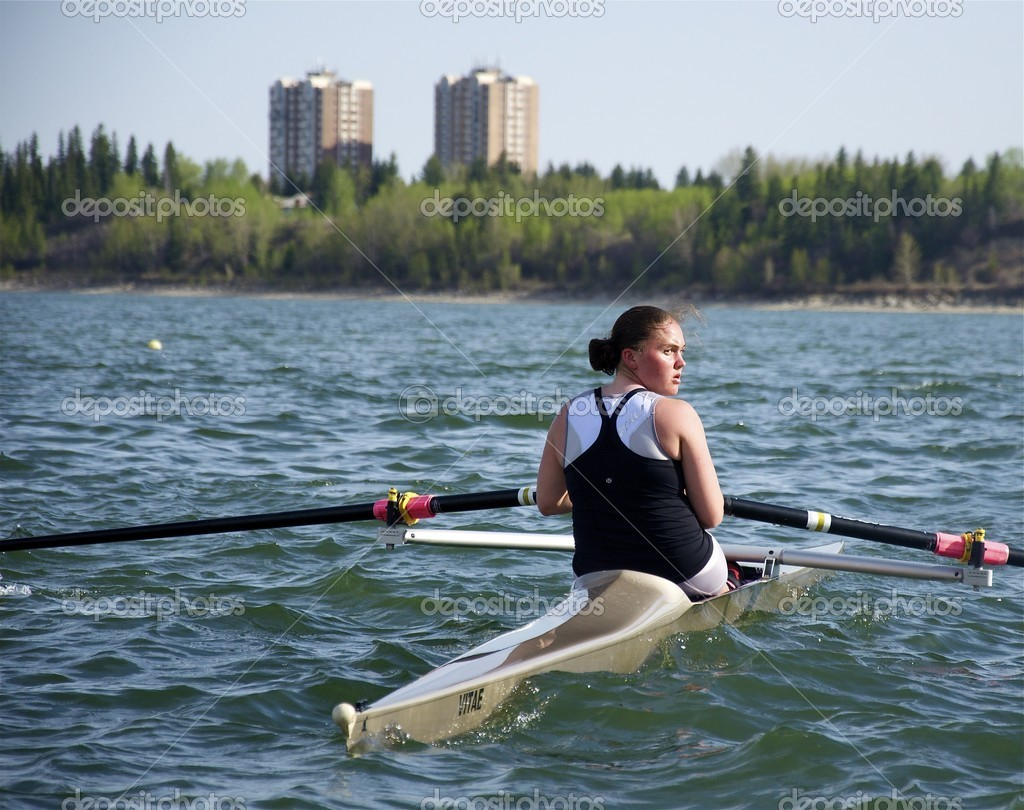 MAY 2012, CALGARY, AB - A young female rower glances over her shoulder at the end of a speed drill on the GLENMORE RESEVOIR. — Stock Photo #11180201
