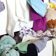 Messy child room with cloth in the drawer — Stock Photo #11123700