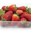 Strawberry pile isolated package — Stock Photo