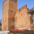 Foto de Stock  : Wall of Warsaw castle and empty bench