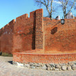Wall of Warsaw castle panorama background - Stock Photo
