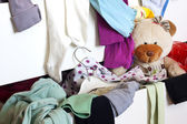 Messy child room with cloth in the drawer — Stock Photo