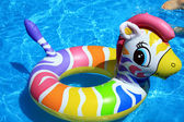Toy and blue water in the swimming pool — Stock Photo