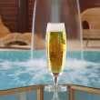 Royalty-Free Stock Photo: Glass of beer with falling water at pool