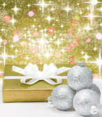 Christmas gold gift and silver baubles decoration — Stockfoto