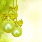 Christmas green background with baubles — Stock Photo