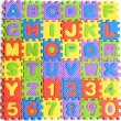 Colorful letters numbers toys abstract background — Stock Photo #11671161