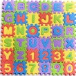 Colorful letters numbers toys abstract background — Stock Photo
