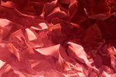 Creased red paper vintage abstract background texture — ストック写真