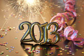 2013 happy new year party with serpentines and sparklers — Stock Photo