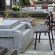Stock Photo: Empty bench on cemetery and forgotten grave
