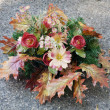 Autumn decoration on grave on cemetery — Stock Photo