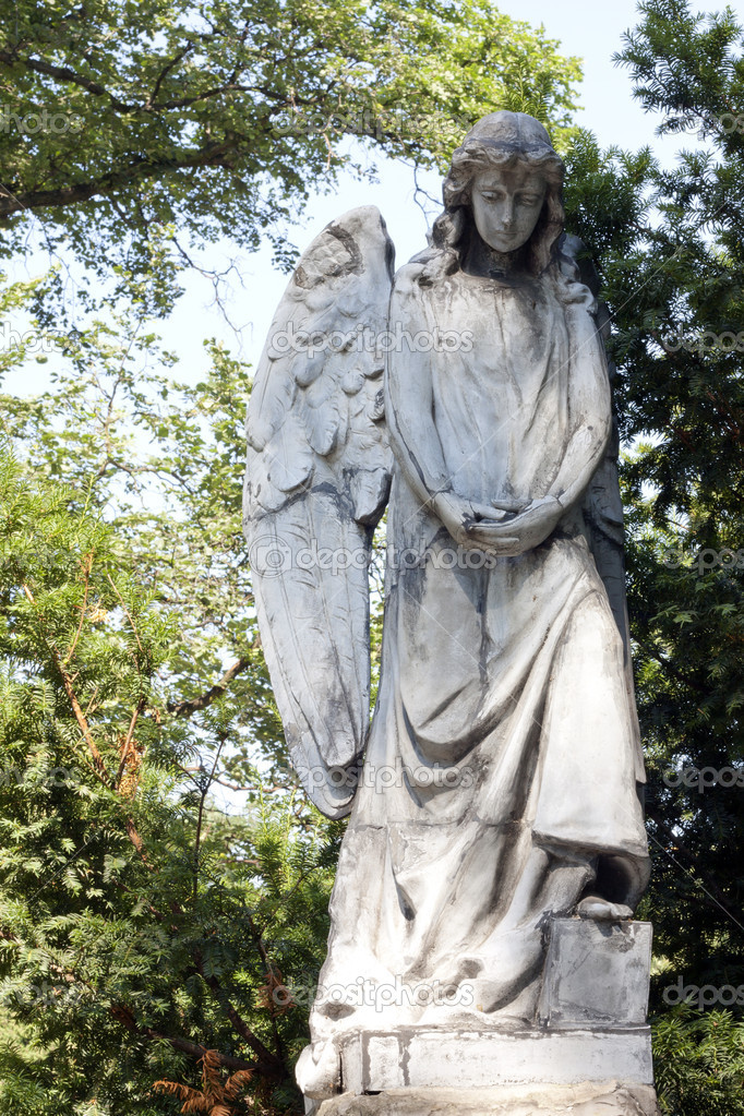 Ancient sculpture of angel on cemetery  Stock Photo #11939359