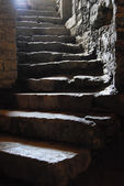 Stairs in a dungeon in an old building — Stock Photo