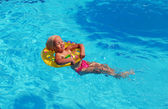 Swimming in the pool — Stock Photo