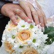 Stock Photo: Honeymoon at hands of bouquet of beautiful flowers