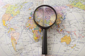 Magnifier on a world map — Stock Photo