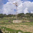Stock Photo: Traditional water pump in maltese countryside