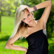 Beautiful girl in the little black dress — Stock Photo