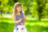Little charming girl outdoors — Stock Photo