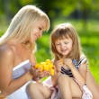 Mother and little daughter at a picnic — Stock Photo #11342401