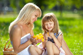 Mother and little daughter at a picnic — Stock Photo