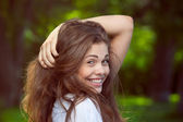 The girl smiling shyly — Stock Photo