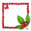 Frame made of cherries and green leaves — Stock Photo