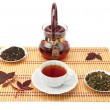 Cup of tea and tea leaves. - Stock Photo