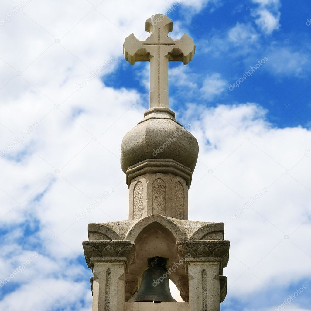 Stone cross on blue sky background — Stock Photo #10831907
