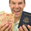Tourist with pesos and passport — Foto Stock