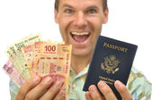 Tourist with pesos and passport — Stock Photo