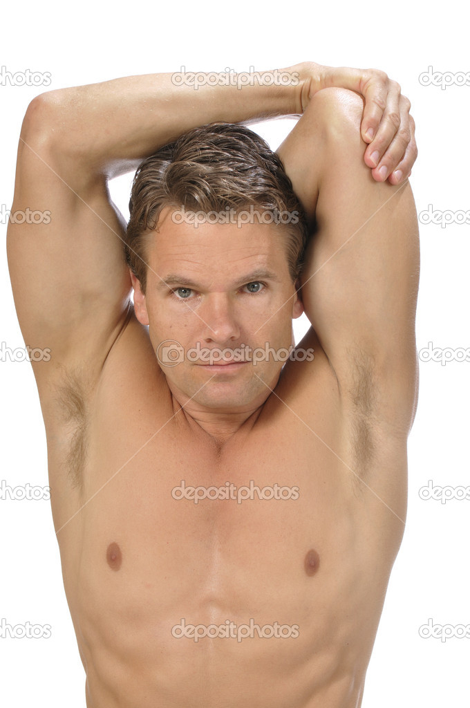 Muscular athletic shirtless man performing triceps stretch on white background  Foto Stock #11905902