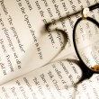 Image of glasses lying on a book — Stock Photo