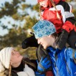Стоковое фото: Girl sitting on the father's shoulders